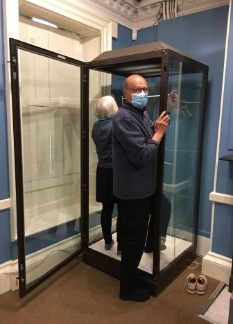 David Dent, Chairman of the Lowewood Museum Trust CIO, preparing the temporary exhibition space ahead of re-opening on Saturday 17 July 2021